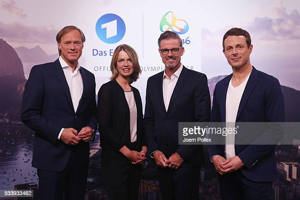 ARD moderator Gerhard Delling ARD moderator Alexander Bommes ARD moderator Jessy Wellmer and ARD moderator Michael Antwerpes pose during a photocall...
