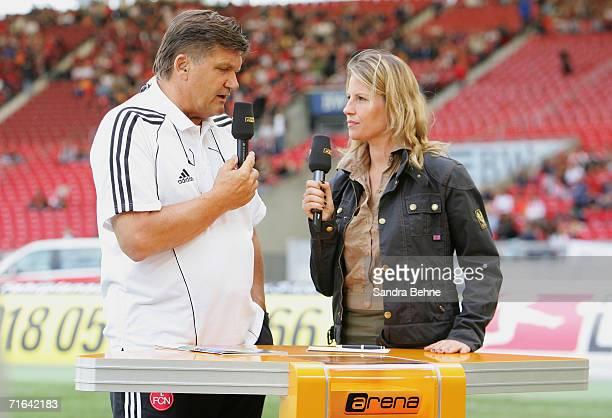 Moderator Isabella Mueller-Reinhard interviews coach Hans Meyer of Nuremberg prior the Bundesliga match between VfB Stuttgart and 1. FC Nuremburg at...