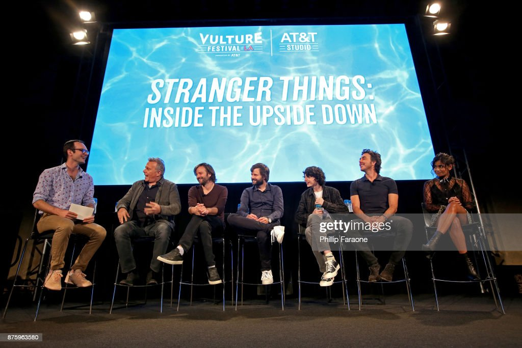 Moderator Jackson McHenry, actor Paul Reiser, writer/producer Matt Duffer, writer/producer Ross Duffer, actor Finn Wolfhard, producer Shawn Levy and actor Linnea Berthelsen speak onstage during the 'Stranger Things: Inside the Upside Down' panel, part of Vulture Festival LA Presented by AT&T at Hollywood Roosevelt Hotel on November 18, 2017 in Hollywood, California.