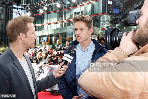 Moderator Jan Hahn with ConCrafter during the Berlin premiere of the film 'Angry Birds Der Film' at CineStar on May 1 2016 in Berlin Germany