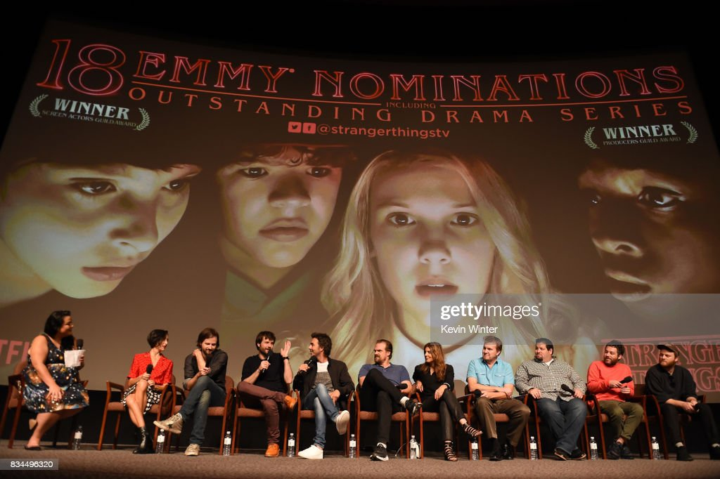 Moderator Janelle Riley, Carmen Cuba, Matt Duffer, Ross Duffer, Shawn Levy, David Harbour, Nora Felder, Kevin Ross, Dean Zimmerman, Kyle Dixon and Michael Stein speak onstage at a reception and q&a for Netflix's 'Stranger Thing' at the Directors Guild on August 17, 2017 in Los Angeles, California.