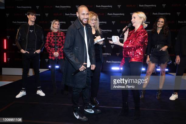 Moderator Janin Ullmann chats with Neymar Jr during the launch event for the new Capsule Collection Neymar Jr x Replay at Weltstadthaus on February...