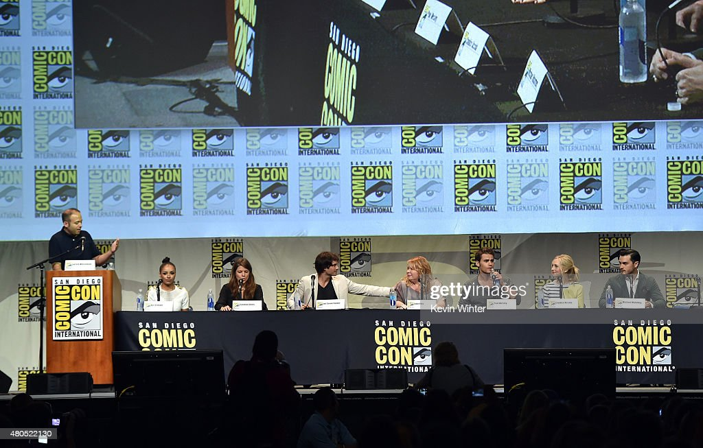 Moderator Jarett Wieselman, actress Kat Graham, producer Caroline Dries, actor Ian Somerhalder, actress Julie Plec, actor Paul Wesley, actress Candice Accola and actor Michael Malarkey speak onstage at the 'The Vampire Diaries' panel during Comic-Con International 2015 at the San Diego Convention Center on July 12, 2015 in San Diego, California.