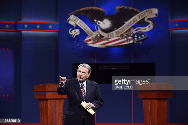 Moderator Jim Leher stands on stage before the first presidential debate between their husbands on October 3 2012 in Denver Colorado AFP PHOTO / Saul...