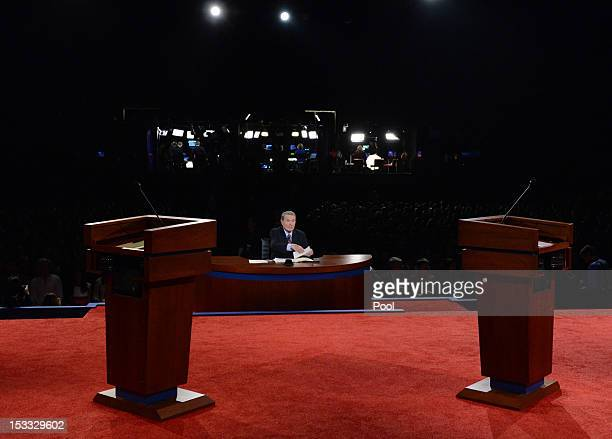 Moderator Jim Lehrer sits at his desk before the Presidential Debate between US President Barack Obama and Republican presidential candidate and...