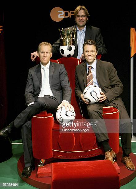 Moderator Johannes B Kerner expert Juergen Klopp and expert Urs Meier of ZDF pose for the media before a press conference with German TV channels ARD...