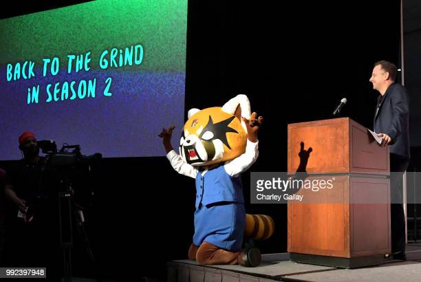 Moderator john Derderian and Aggretsuko onstage during the Netflix presents Netflix<3Anime panel during Anime Expo 2018 at Los Angeles Convention...