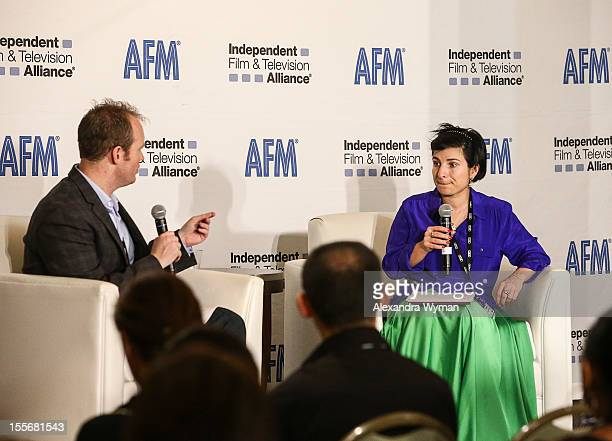 Moderator Kevin Clark and Head of Inernational Department Russian Cinema Fund Elena Romanova speak at International Production Incentives at the...