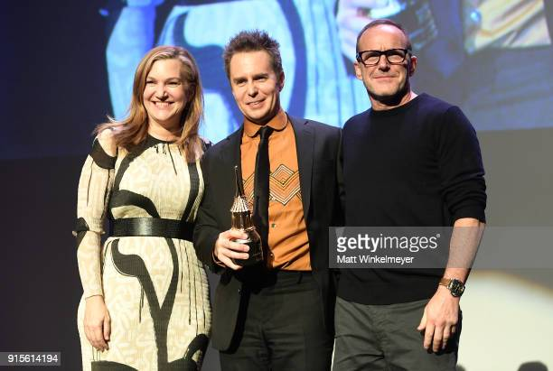 Moderator Krista Smith actors Sam Rockwell and Clark Gregg pose onstage with The American Riviera Award at The American Riviera Award Honoring Sam...