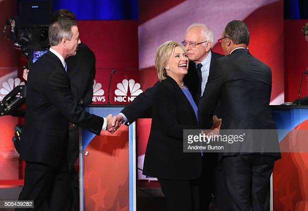 Moderator Lester Holt greets Democratic presidential candidates Martin O'Malley Hillary Clinton and Sen Bernie Sanders following the Democratic...