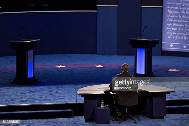 Moderator Lester Holt sits on stage during rehearsal for the first US presidential debate inside the debate hall ahead of the first US presidential...