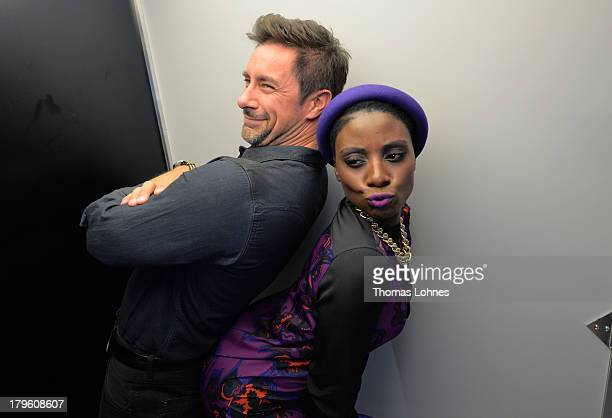 Moderator Marco Schreyl and dancer and choreographer Nikeata Thomason pose in a photo booth during the opening of the Diesel flagship store on...
