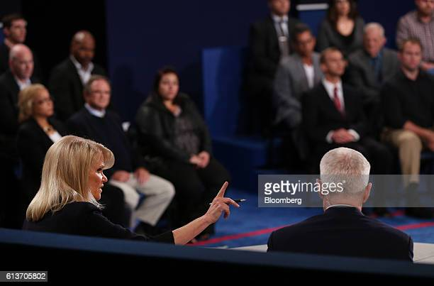 Moderator Martha Raddatz left speaks as Anderson Cooper sits during the second US presidential debate at Washington University in St Louis Missouri...