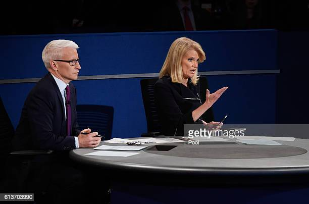 Moderator Martha Raddatz of ABC speaks as moderator Anderson Cooper of CNN looks on during the town hall debate at Washington University on October 9...