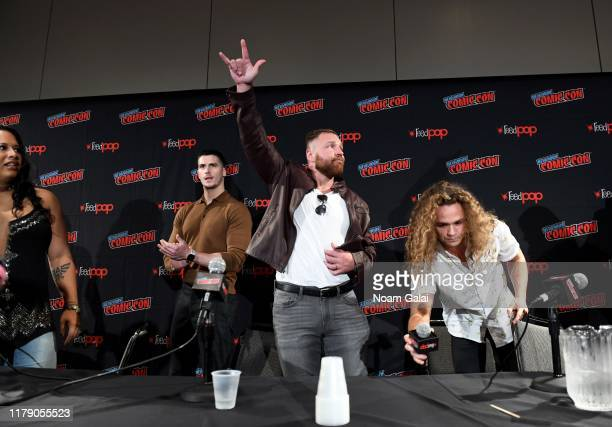 Moderator Mick Rouse Jon Moxley and Jack Perry aka Jungle Boy attend the All Elite Wrestling panel during 2019 New York Comic Con at Jacob Javits...