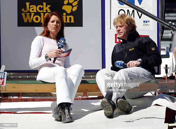 TV moderator Monika Lierhaus and former german ski jumping star Dieter Thoma look on prior the first heat of the FIS Ski Flying World Team...