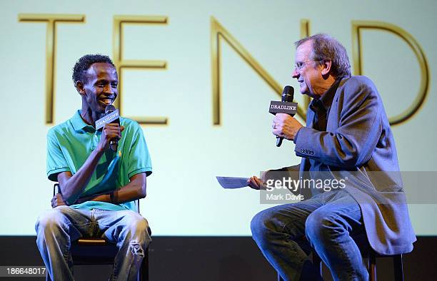 Moderator Pete Hammond listens to actor Barkhad Abdi onstage during Deadline Hollywood's The Contenders on November 2 2013 in Beverly Hills California