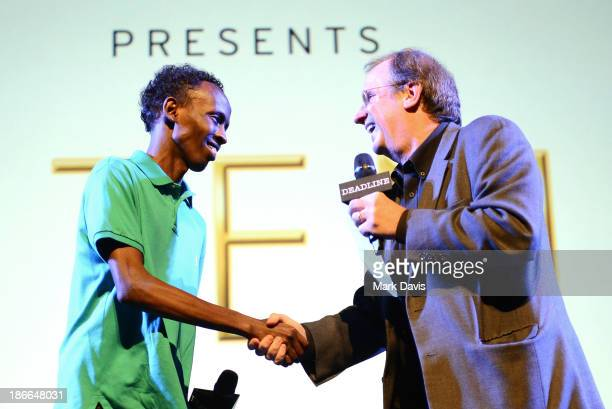 Moderator Pete Hammond shakes hands witht actor Barkhad Abdi onstage during Deadline Hollywood's The Contenders on November 2 2013 in Beverly Hills...
