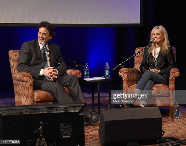 Moderator Peter Cooper and Singer/Songwriter Kim Carnes attend The Country Music Hall Of Fame And Museum Presents 'Conversation And Performance Kim...