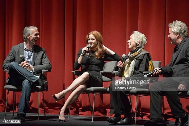 Moderator Scott Mantz actress Amy Adams artist Margaret Keane and writer Larry Karaszewsk speak onstage during The Weinstein Company's Big Eyes Los...