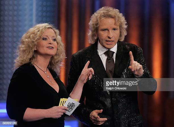 Moderator Susanne Froehlich and TV host Thomas Gottschalk gesture during the live broadcast of Wetten dass on ZDF television at the Festhalle on...