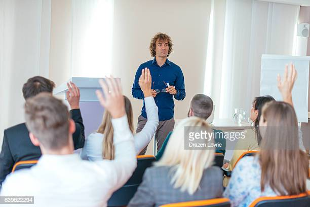 Moderator talking to participants on seminar