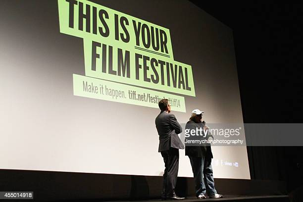 Moderator Thom Powers and Director / Executive Producer Michael Moore speak during the 25th Anniversary screening of Roger Me during the 2014 Toronto...