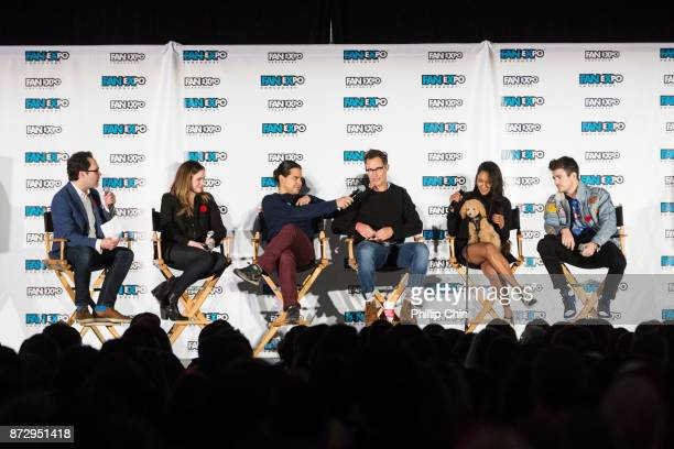 Moderator Thor Diakow talks with actors Danielle Panabaker Carlos Valdes Tom Cavanagh Candice Patton and Grant Gustin during 'The Flash QA at Fan...