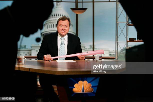 Moderator Tim Russert holds a baseball bat during a taping of Meet the Press in this file photo from May 13 2007 in Washington DC Russert died June...