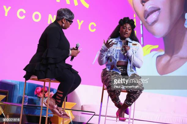 Moderator Ty Alexander and actor Danielle Brooks speak on a panel during Beautycon Festival NYC 2018 Day 2 at Jacob Javits Center on April 22 2018 in...