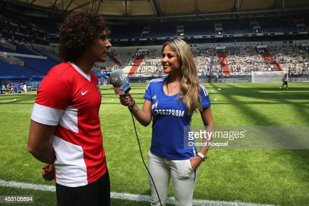 Moderator Vanessa Huppenkothen embraces Gillermo Ochoa of Malaga prior to the match between FC Malaga and West Ham United as part of the Schalke 04...