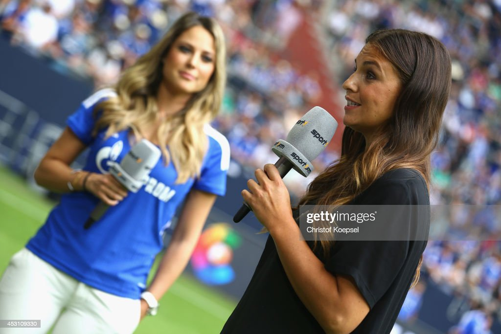 Moderator Vanessa Huppenkothen of Sport 1 television channel speaks to Laura Wontorra (R) of Sport 1 television prior to the match between FC Malaga and West Ham United as part of the Schalke 04 Cup Day at Veltins-Arena on August 3, 2014 in Gelsenkirchen, Germany.