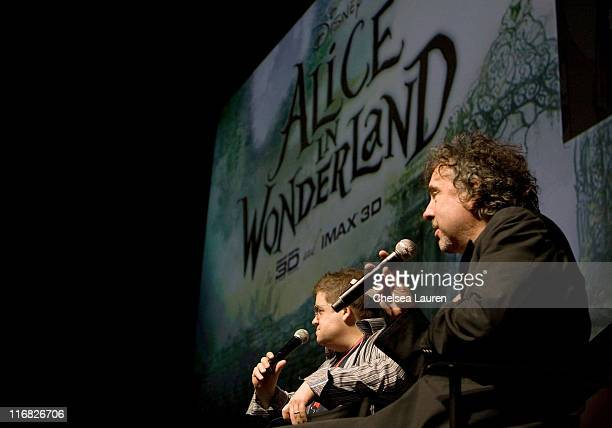 Moderator/actor Patton Oswalt and director/producer Tim Burton speak at 'Alice in Wonderland' press conference during ComicCon 2009 held at San Diego...