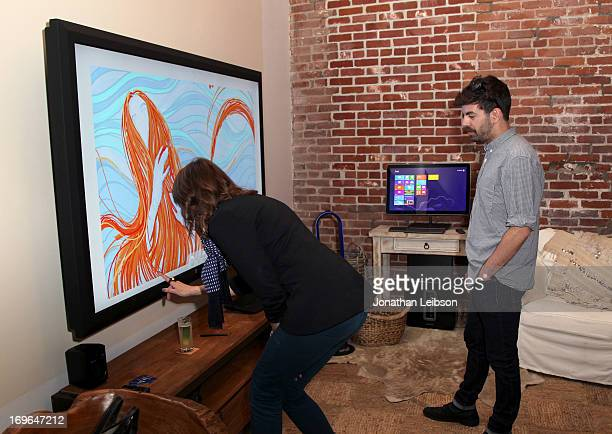 Moderator/Los Angeles Confidential West Coast Group Publisher Alison Miller and artist Derek Sterkel interact with Fresh Paint at The Microsoft...