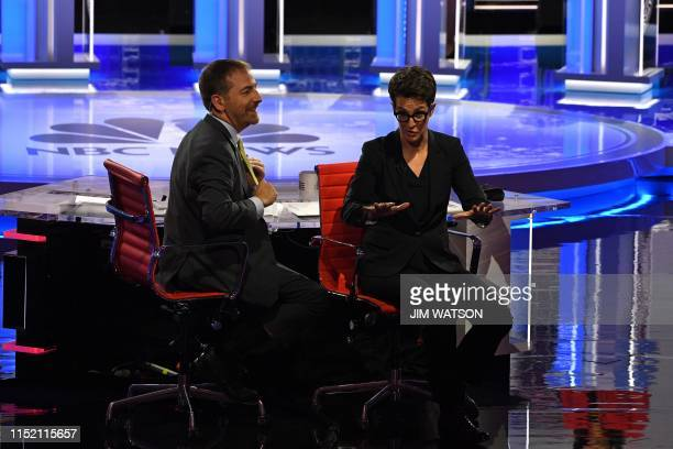 Moderators Chuck Todd and Rachel Maddow speak to audience during a technical problem as they host the first night of the Democratic presidential...