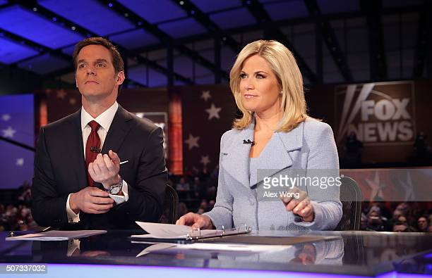 Moderators Martha MacCallum and Bill Hemmer wait for the beginning of the first forum of the Fox News - Google GOP Debate January 28, 2016 at the...
