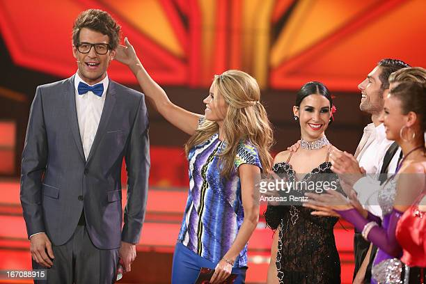 Moderators Sylvie van der Vaart and Daniel Hartwich gesture during the 3rd Show of 'Let's Dance' on the German RTL network on April 19 2013 in...