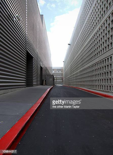 modern alley - curb stock pictures, royalty-free photos & images