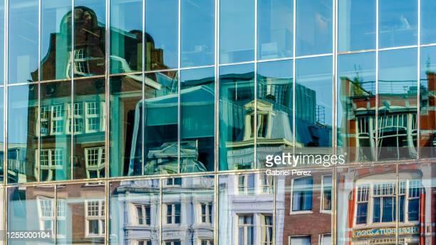 a modern amsterdam building - amsterdam stock-fotos und bilder