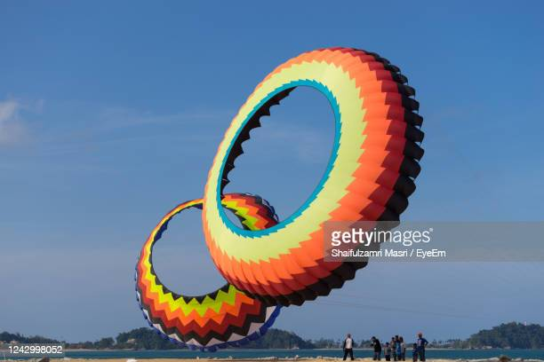 a modern and big kite festival during hot and windy season in terengganu, malaysia. - shaifulzamri eyeem stock pictures, royalty-free photos & images