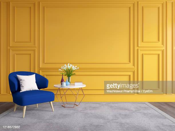 modern and classic living room interior design, classic blue sofa with yellow wall - domestic room stock pictures, royalty-free photos & images