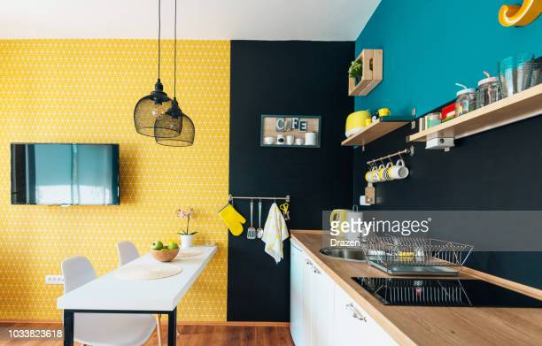 modern and cozy studio apartment and small kitchen - fashionable stock pictures, royalty-free photos & images