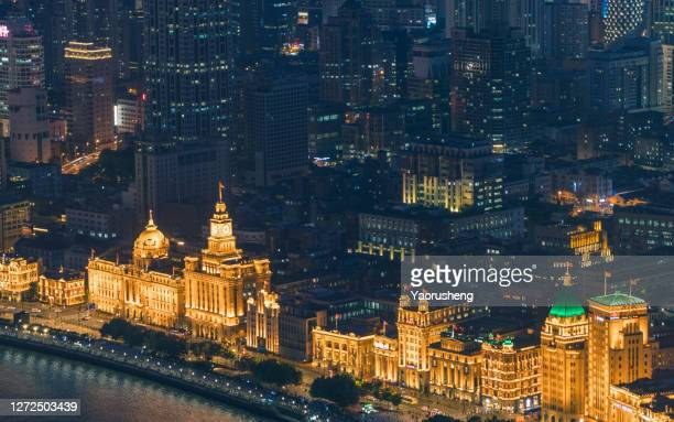 modern and history,aerial view of shanghai bund in night - china east asia stock pictures, royalty-free photos & images