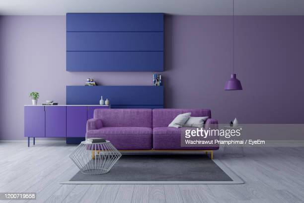 modern and minamalist interior ,ultraviolet home decor concept, purple armchair on purple wall - lilac fashin stock pictures, royalty-free photos & images