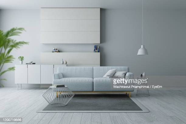 modern and minimalist interior of living room, blue armchairs on white flooring and white wall - living room wallpaper stock pictures, royalty-free photos & images
