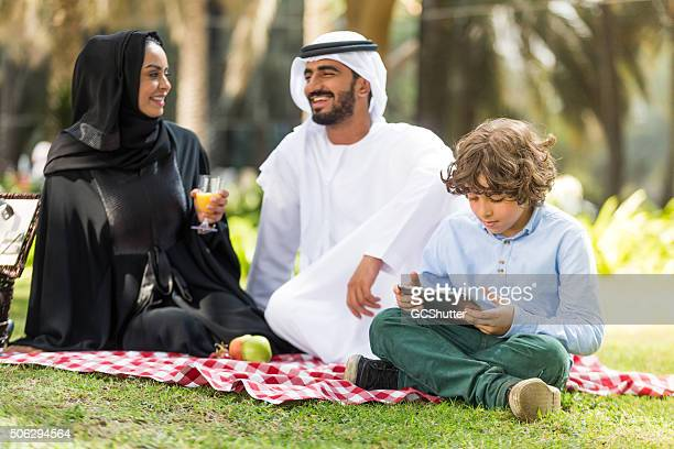 Modern Arab Couple with their Son in a park