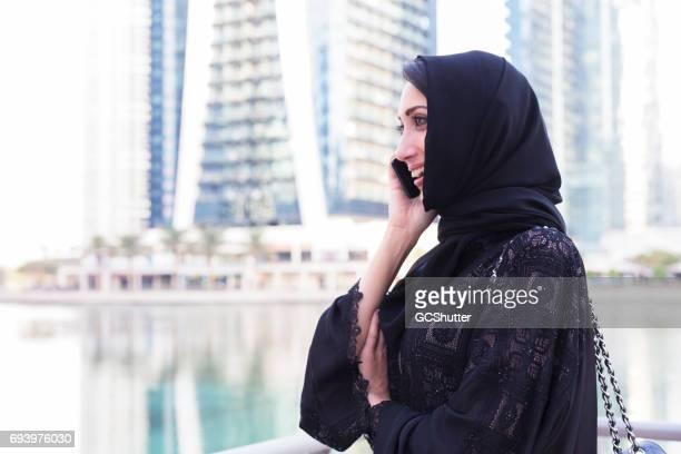Modern Arab woman having a conversation on her phone