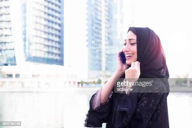 Modern Arab woman talking on her smart phone