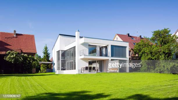 modern architecture home green on green summer meadow - house stock pictures, royalty-free photos & images