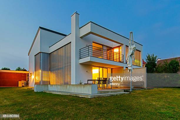 modern architecture house home illuminated at twilight - bauhaus art movement stock pictures, royalty-free photos & images